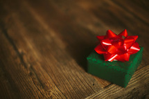 A Christmas present on a wooden table