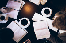 open Bibles and coffee mugs at a Bible study