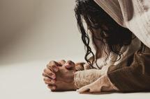 Jesus praying - isolated on white