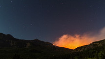 time-lapse of burning wildfire on a mountain